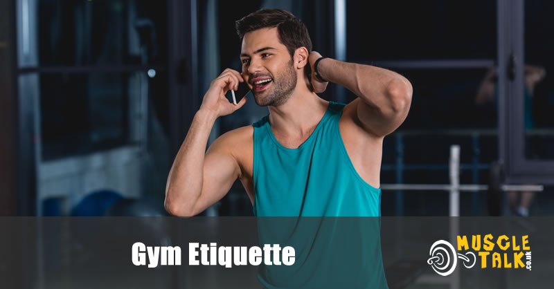 Man talking on phone in gym