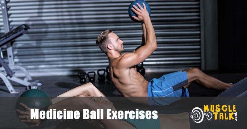 Couple doing medicine ball exercises