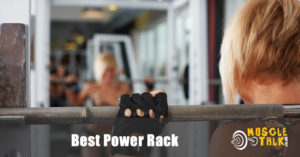 Power rack being used by female in the gym