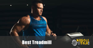 muscular man running on a treadmill