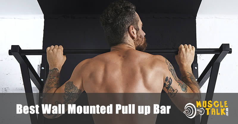 man doing pull-ups on a wall bar