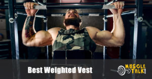 Man using a weighted vest to do pull-ups