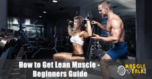Couple with lean muscle training in the gym