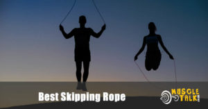 Man and woman jumping / exercising with skipping ropes