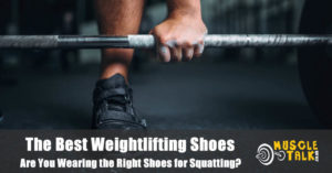 Squatting while wearing a pair of weightlifting shoes