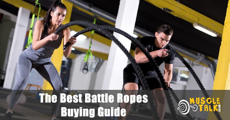 Two people training hard with battle ropes
