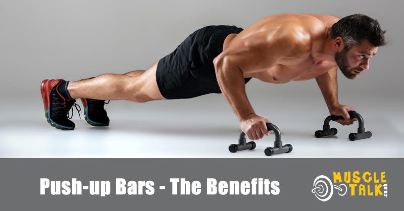Guy exercising using push-up bars