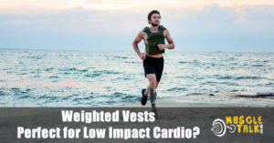 Man jogging on the beach wearing a weighted vest