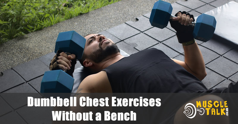 man doing chest press with dumbbells on the floor