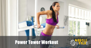 woman doing a power tower workout in the gym
