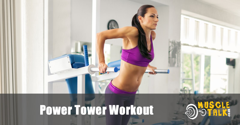 woman using a power tower in the gym