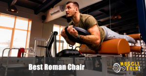 man using a roman chair in the gym